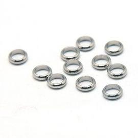 Nerūdijančio plieno 304 uždari žiedeliai. Akmenėliai skirti suvenyrams papuošalams, rankdarbiams, smulkmenoms gaminiti. Nikelio
