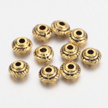 Intarpas . Sendintos aukso spalvos; rondelės formos; kaina - 0;4 Eur už 1 maišelis vėrimui rankdarbiams