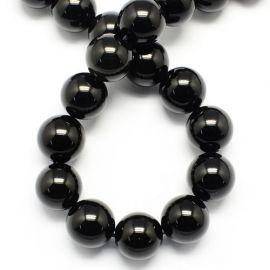 Obsidiano karoliukai . Juodos spalvos su žalios spalvos žėrėjimu, apvalios formos