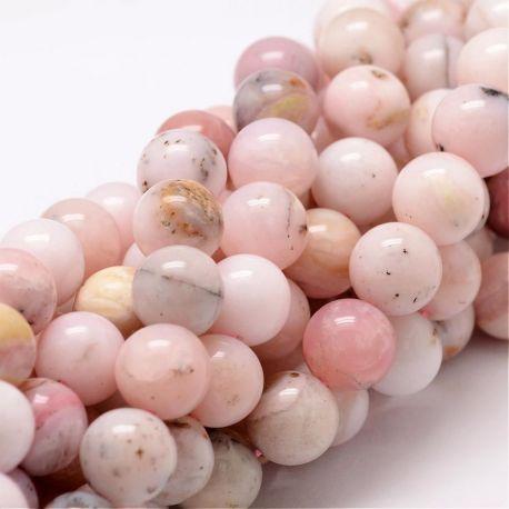 Natūralūs rausvojo opalo karoliukai . Rausvos-gelsvos-baltos spalvos su juodos spalvos intarpais, apvalios formos, kaina - 20 Eu