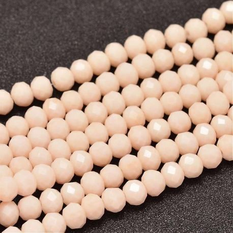 Stikliniai karoliukai . Šviesios persiko spalvos su blizgesiu, rondelės formos, kaina - 1,6 Eur už 1 gija