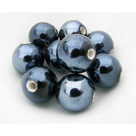 Rankų darbo keramikiniai karoliukai. Tamsiai mėlynos spalvos, netaisyklingos apvalios formos, kaina - 0,3 Eur už 1 vnt