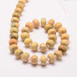 Natūralūs geltonojo agato karoliukai. Gelsvos-pilkos spalvos dydis 11x7 mm