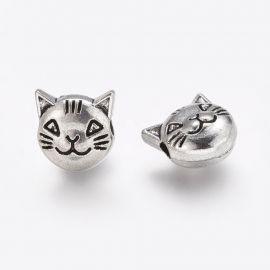 """Intarpas """"Kačiuko veidukas"""" skylės diametras ~2 mm.. Sendintos sidabro spalvos dydis 8x8x5 mm"""