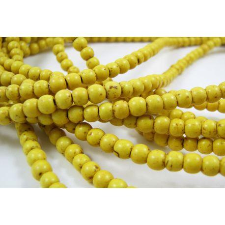 Sintetinio turkio karoliukai - gija, geltonos spalvos, apvalios formos, dydis apie 3-4 mm