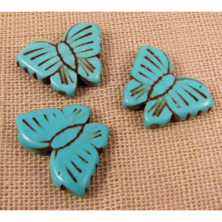 Sintetinio turkio karoliukai, žydros spalvos, drugelio formos, dydis 48x30 mm