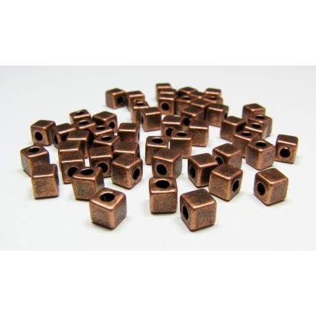 Intarpas skirtas papuošalų gamybai, sendintos vario spalvos, kubo formos, dydis 4x4 mm, 1 vnt