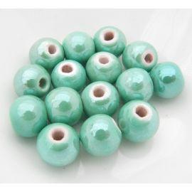 Rankų darbo keramikiniai karoliukai, vėriniams, papuošalams. Blizgios žaliai žydros spalvos, dydis 10 mm, kaina už 1 vnt.