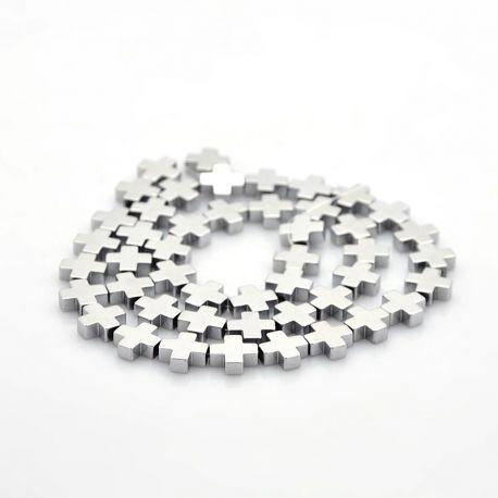 Akmeniniai karoliukai skirti papuošalų, rankdarbių, suvenyrų gamyboje. Sidabro spalvos, kryžiaus formos, kaina - 0,3 Eur už 1