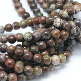 Natūralūs Afrikos opalo karoliukai - akmenėliai papuošalams, suvenyrams verti. Rudos-baltos-žalsvos spalvos, apvalios formos,